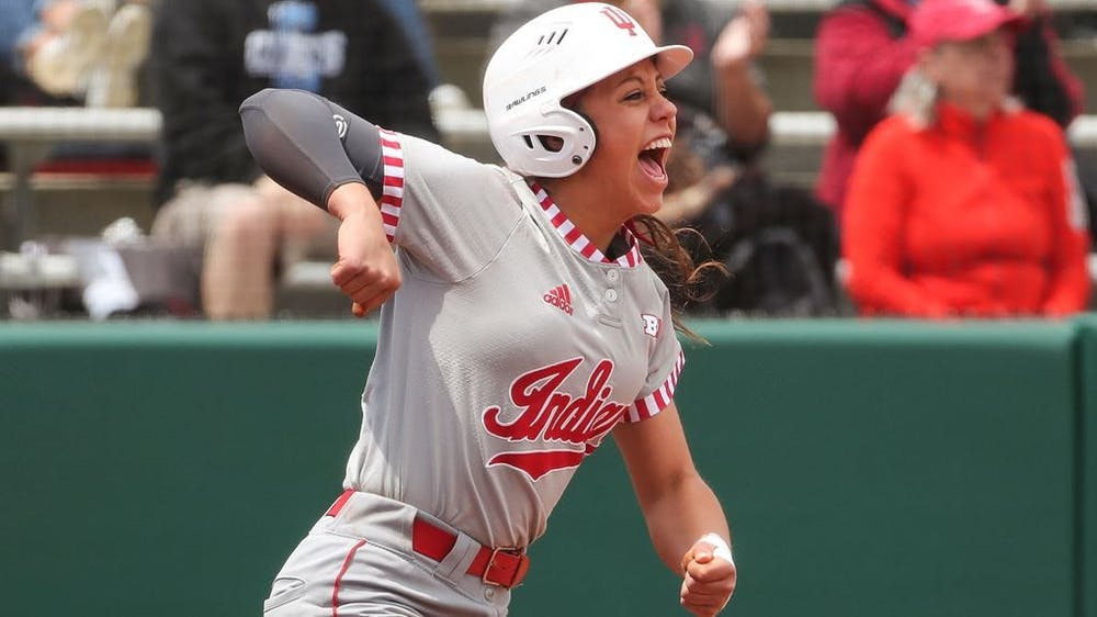 Then-sophomore catcher Bella Norton celebrates on the field April 28, 2019, at Andy Mohr Field. Norton was named Big Ten co-Player of the Week on Tuesday
