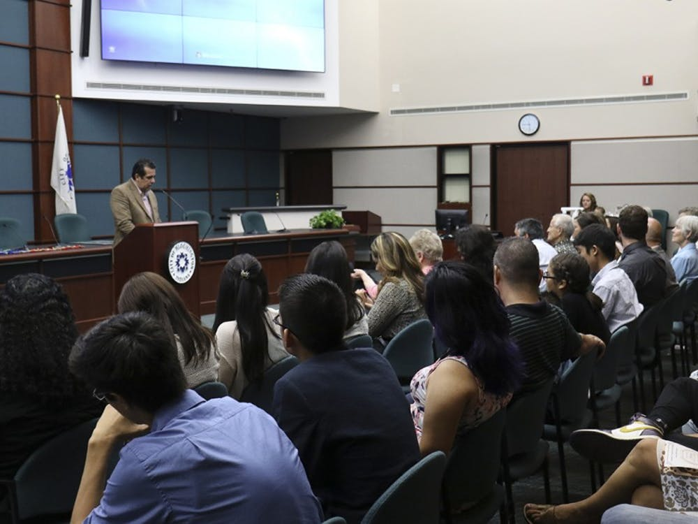 Israel Herrera, a member of the Commission on Hispanic and Latino Affairs welcomes the community to the Annual Award Ceremony for the Commission on Hispanic and Latino Affairs Wednesday evening at City Hall.