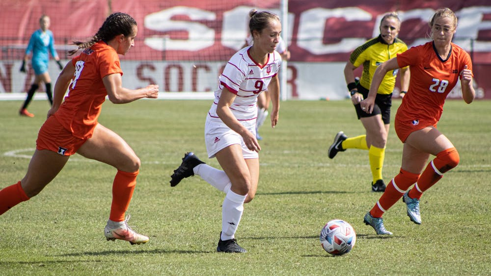 Freshman forward Jordyn Levy dribbles past an Illinois player Sept. 26, 2021, at Bill Armstrong Stadium. Indiana defeated Illinois 2-1.