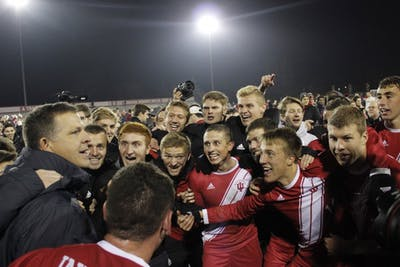 Head coach Todd Yeagley congratulates his players on winning the quarterfinals of the NCAA Tournament on Nov. 30 at Armstrong Stadium. The Hoosiers will move on to the next round of the tournament following a 1-0 win against Notre Dame.
