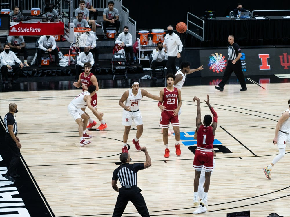 Senior guard Al Durham shoots a 3-pointer Thursday at Lucas Oil Stadium in Indianapolis. The Hoosiers lost 61-50 to Rutgers in the first round of the Big Ten Championships.