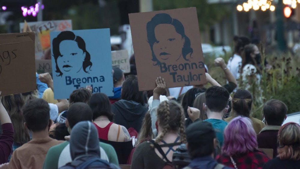 Protesters march, chant and hold up signs for Breonna Taylor  Sept. 23 in downtown Bloomington. People took turns addressing the group and leading different chants.