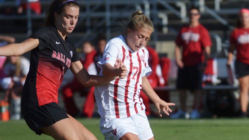 Sophomore Midfielder Kayla Smith holds off a Ball State University Cardinals' defender at Bill Armstrong stadium on Sunday evening. IU tied the game 1-1.