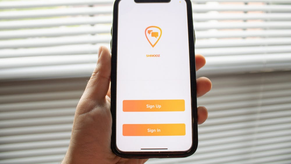 The login screen for the Schmooz app is pictured. Schmooz is a location-based messaging app created by IU college students.