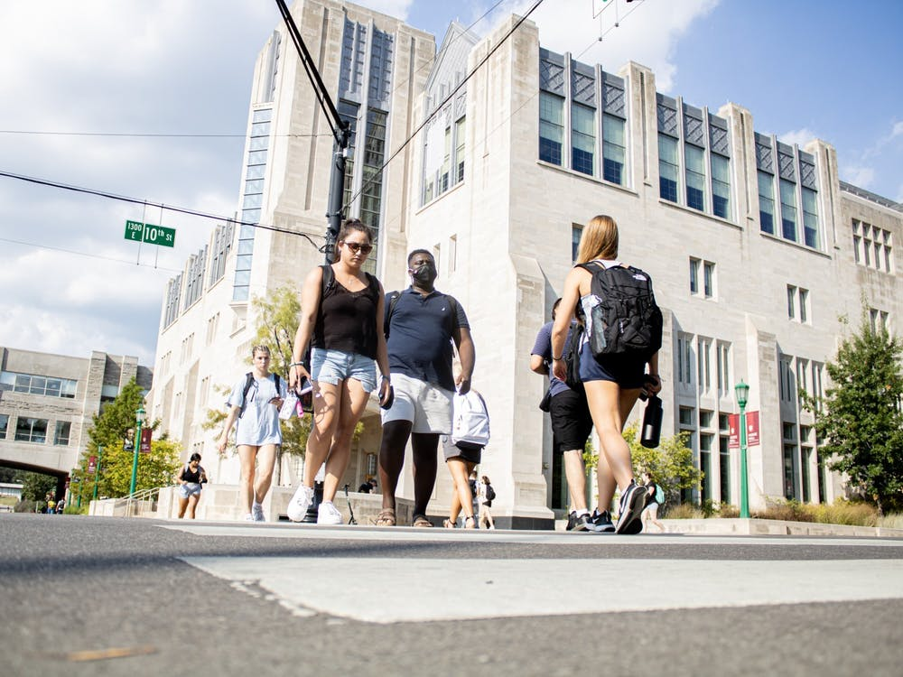 Students cross the street Aug. 24, 2021, at the corner of North Fee Lane and East 10th Street.