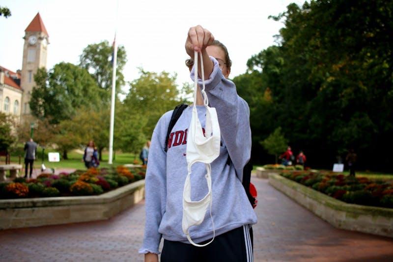 Sophomore Alexandra Deryn holds up a bra at Sample Gates.
