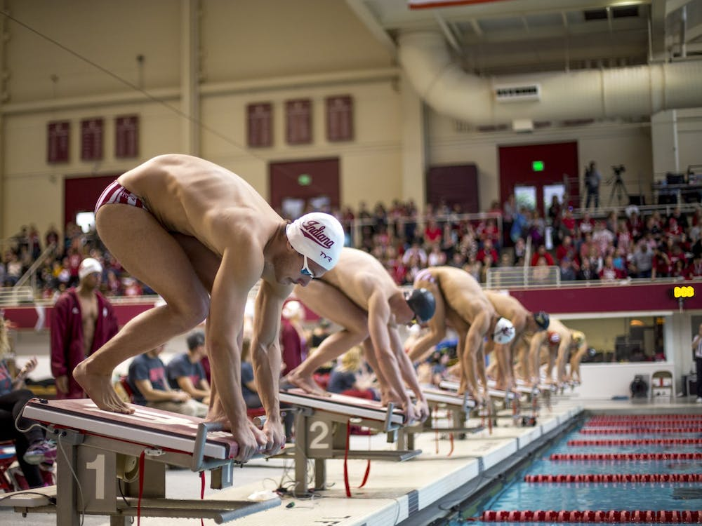 Then-freshman, now-junior Bruno Blaskovic prepares to dive into the pool for the men's 100-meter freestyle finals on Jan. 20, 2018. Blaskovic and freshman Brendan Burns received Big Ten conference honors Wednesday.