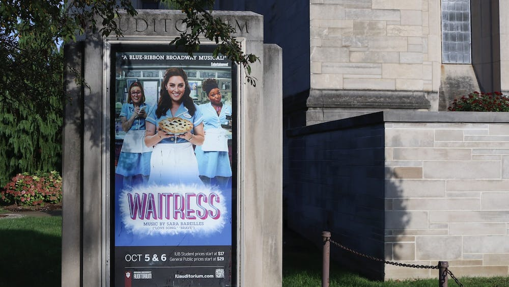 """The poster for """"Waitress"""" is seen on Oct. 4, 2021, outside the IU Auditorium. The show made its Bloomington debut on Oct. 5 and closes Oct. 6."""
