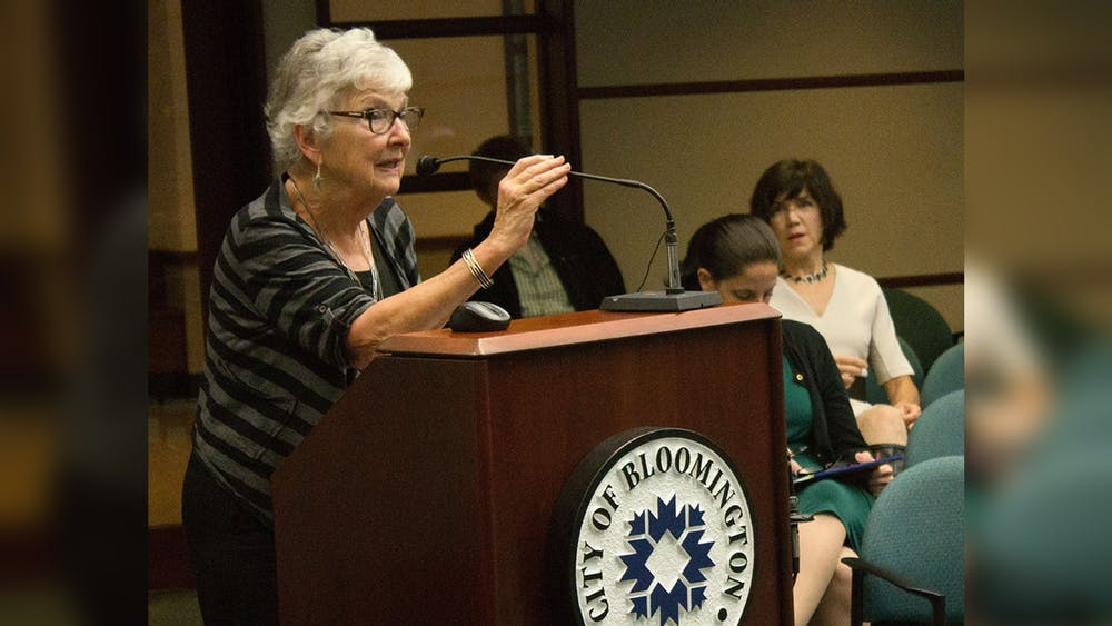 """Charlotte Zietlow, the founder of the Bloomington Commission on the Status of Women, speaks on the commission's 40th anniversary in 2014 at Bloomington City Hall. Zietlow is featured in the Monroe County History Museum's new exhibit  """"See Her Run: Monroe County Women in Politics."""""""