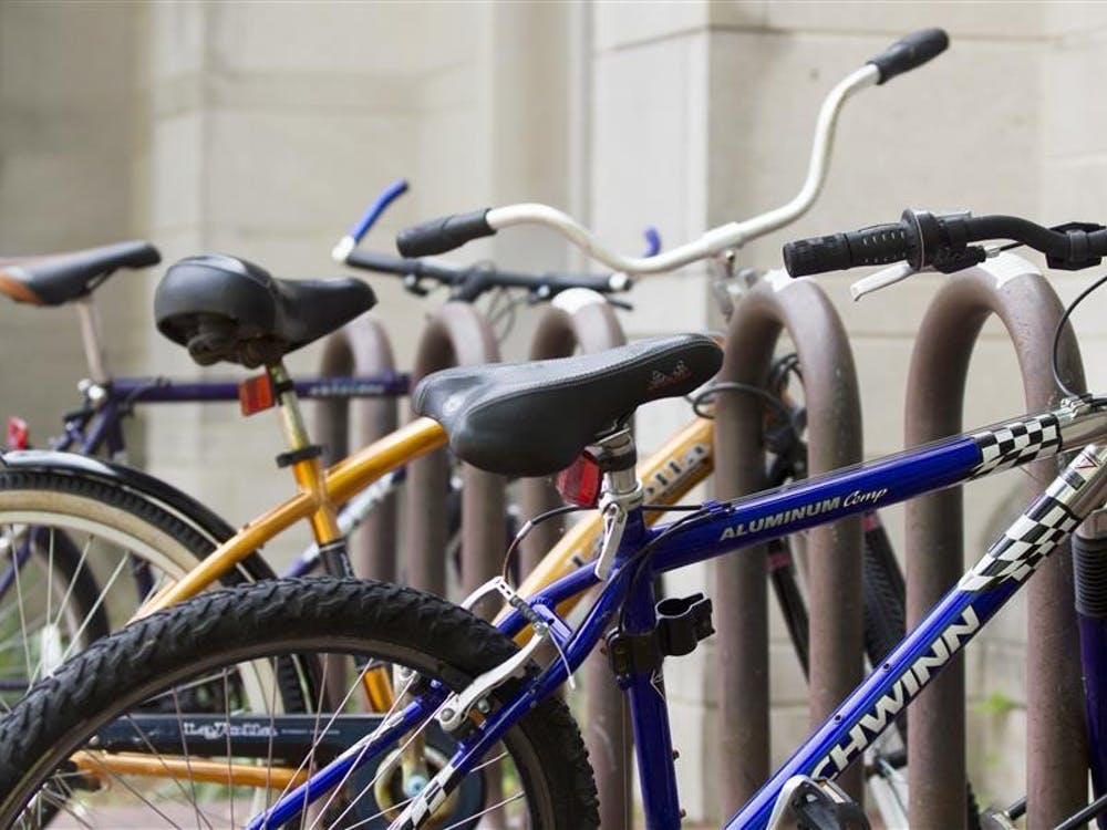 Bikes line a rack outside of the Indiana Memorial Union.