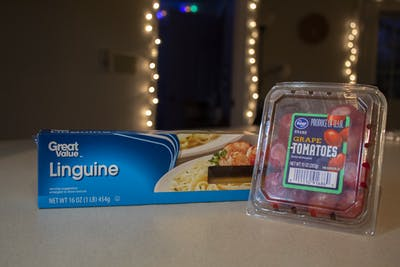 A box of linguine pasta and a package of grape tomatoes sits on the counter of an off-campus apartment in Bloomington.