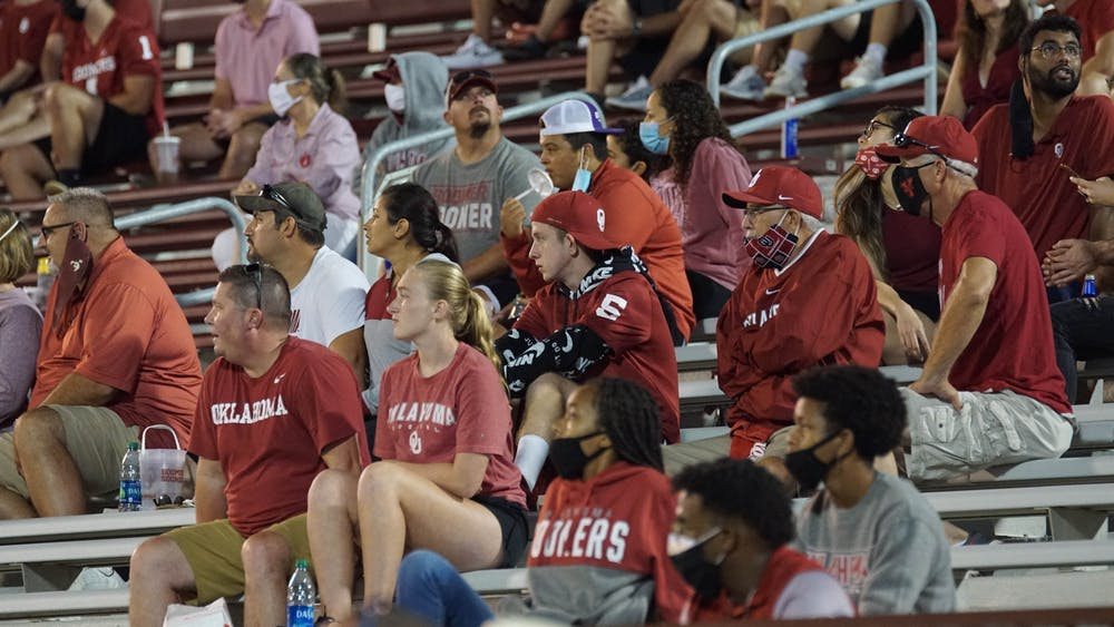 Fans sit in the stands during the Oklahoma University football season opener against Missouri State University on Sept. 12 in Norman, Oklahoma. Different college football conferences have implemented different protocols regarding fan safety due to the coronavirus pandemic, including limits on stadium capacity and mandatory face coverings.