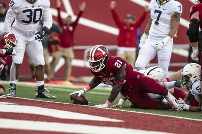 Freshman running back Stevie Scott starts to stand up after stretching for a touchdown during IU's game against Penn State Oct. 20 at Memorial Stadium. Penn State defeated IU 33-28.
