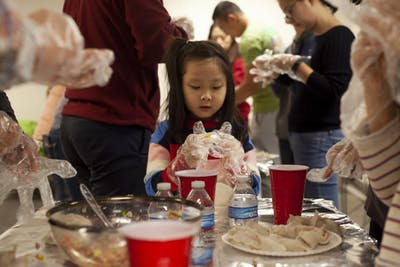 Younjei Choe, 7, celebrates her birthday by making dumplings with her family Feb. 2 at Campus View Apartments. After Choe made each dumpling, she would show her mom before working on the next one.