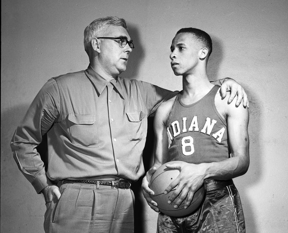 <p>Former IU basketball head coach Branch McCracken stands with Bill Garrett in 1951. The IU Board of Trustees unanimously approved to name the Intramural Center on campus after Garrett, who was the first Black basketball player in the Big Ten. </p>