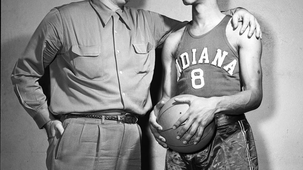 Former IU basketball head coach Branch McCracken stands with Bill Garrett in 1951. The IU Board of Trustees unanimously approved to name the Intramural Center on campus after Garrett, who was the first Black basketball player in the Big Ten.