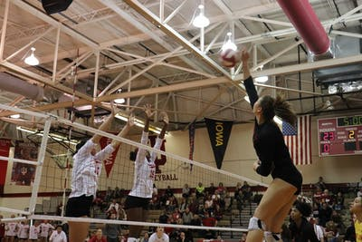 Senior right side hitter Elizabeth Asdell and junior middle blocker Deshia Lofton attempt to block Maryland's hitter Erika Pritchard on Oct. 21. Pritchard had 20 kills in Maryland's 3-0 win over IU.