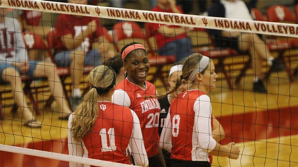 Members of the IU women's volleyball team celebrate after scoring a point during the Hoosiers' game against Bowling Green on Sep. 12. IU swept the Indiana Invitational.