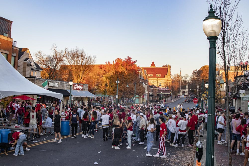 <p>IU students join together in celebration Nov. 7 on Kirkwood Avenue in Bloomington. IU defeated Michigan earlier that day, 38-21.</p>