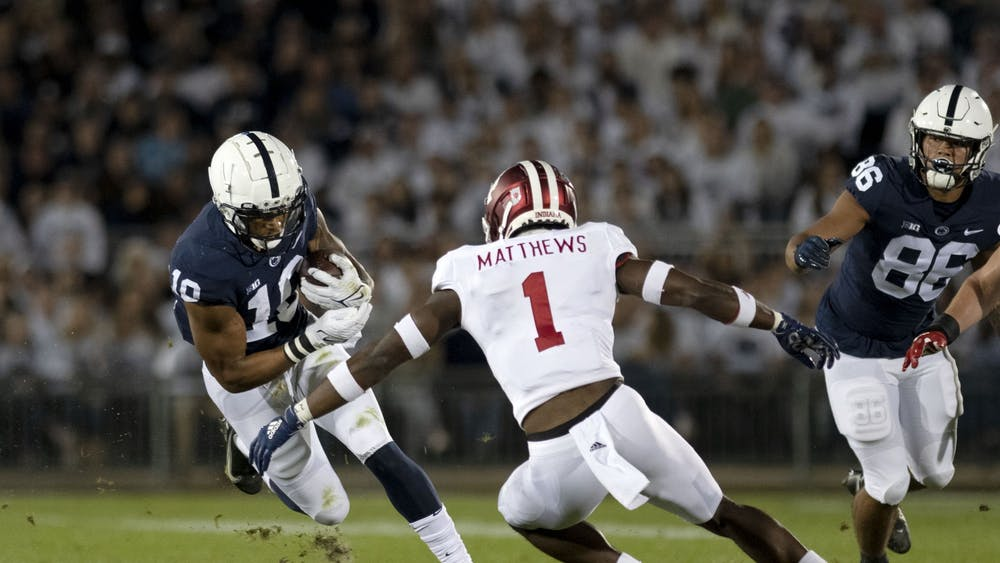 Senior Devon Matthews attempts to tackle a Penn State player Oct. 2, 2021, at Beaver Stadium. Indiana lost to Penn State 24-0.