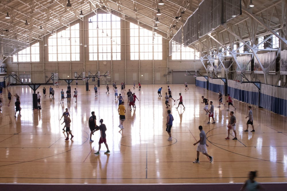 <p>Students play basketball in the then Ora L. Wildermuth Intramural Center in 2018. IU Health physician Kevin Miller said that people should try to exercise outside if possible and that he would consider most gym activities high risk because they&#x27;re inside.</p>