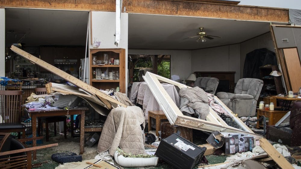 Tina and John Paynter's living room opens up to the outside June 17 in Ellettsville, Indiana. A tornado on June 15 took the entire front of the Paynter family residence.