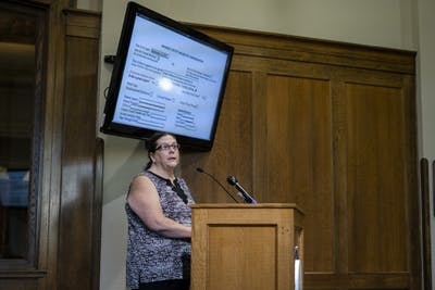 Auditor Catherine Smith speaks at a public hearing Sept. 18 in the Monroe County Courthouse. Smith showed her support for the fire station merger between Bloomington Township and Van Buren Township and gave a personal story of when Smith and her neighbor's house caught fire.