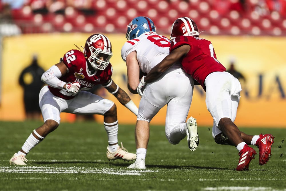 <p>Junior defensive back Jamar Johnson and junior defensive back Devon Mathews prepare to tackle their opponent Jan. 2 at Raymond James Stadium in Tampa, Florida. The Hoosiers finished out their season with a 20-26 loss against Ole Miss in the Outback Bowl. </p>