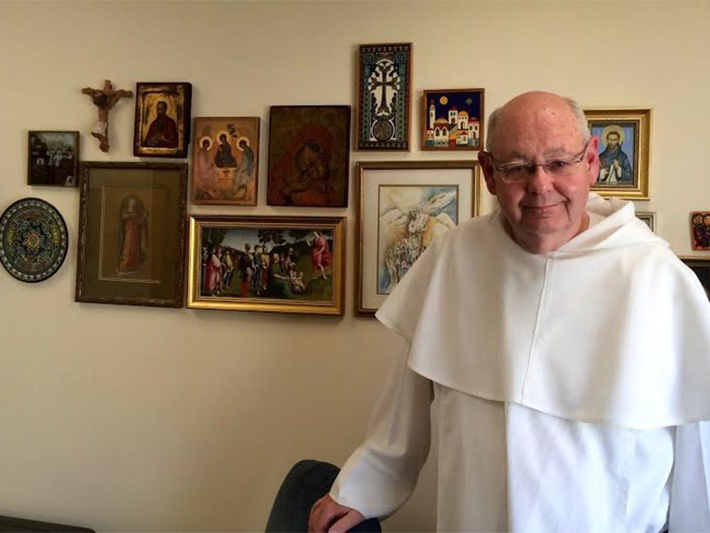 Father John Meany in his office at St. Paul Catholic Center. In the four days since the Pope released his newest document, the pastor has tried to discern what messages to take away.