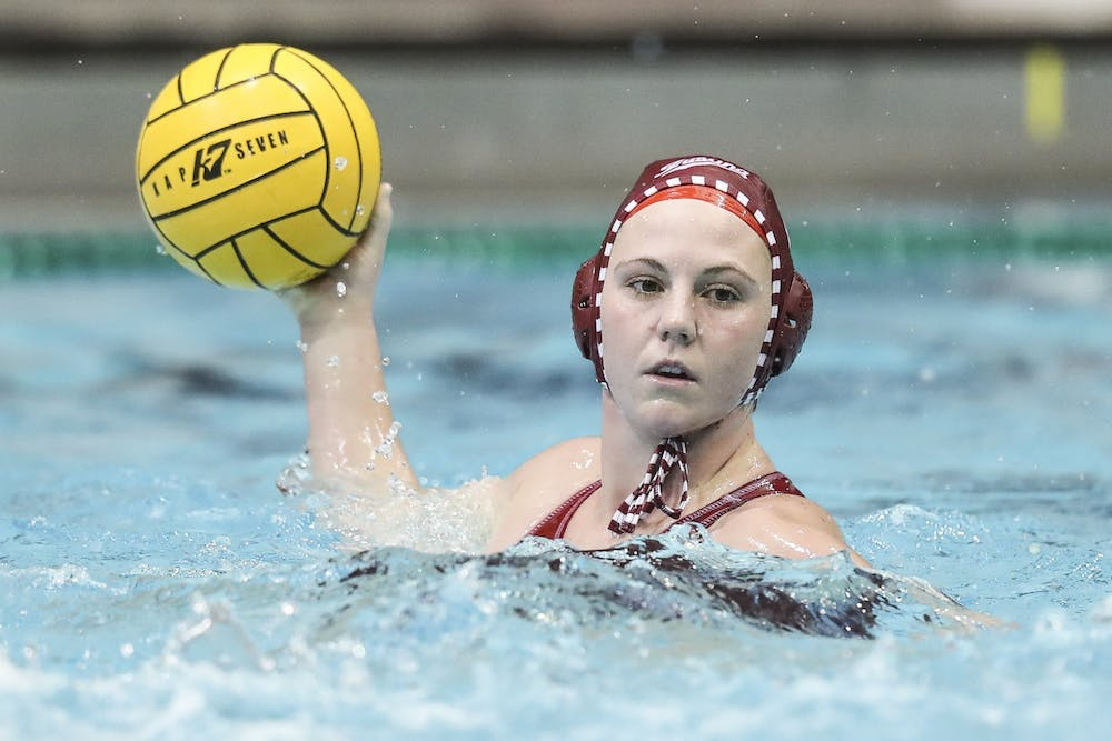 <p>Sophomore utility Zoe Crouch looks to make a pass Saturday at the Michigan Invitational in Ann Arbor, Michigan. The Hoosiers beat Saint Francis 18-7 Saturday. </p>