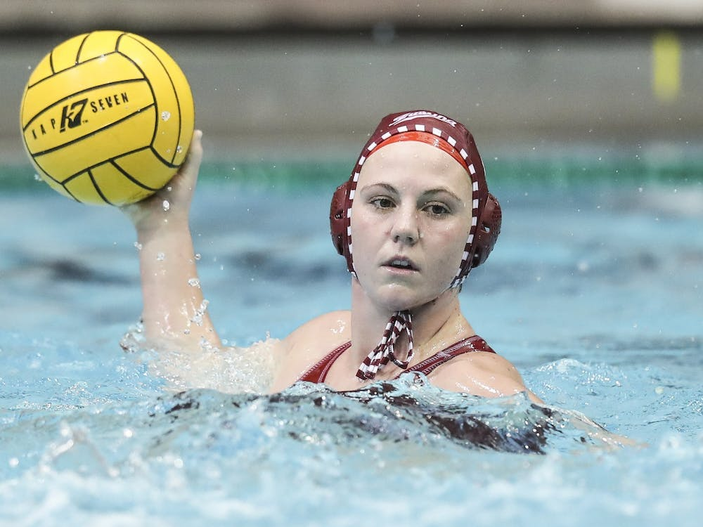 Sophomore utility Zoe Crouch looks to make a pass Saturday at the Michigan Invitational in Ann Arbor, Michigan. The Hoosiers beat Saint Francis 18-7 Saturday.