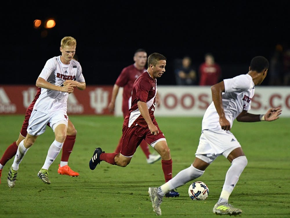 Junior defender Rece Buckmaster dribbles the ball against Rutgers at Bill Armstrong Stadium. IU defeated Rutgers, 5-0, earning their first Big Ten home win of the season.