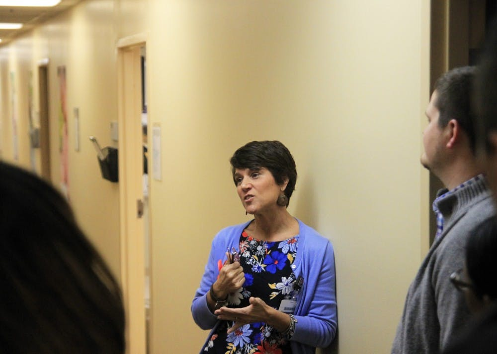 <p>Julie Hiles, a care coordinator at Positive Link, speaks with people on a tour of the facilities. Positive Link HIV Services new clinic will provide direct care to those who are HIV positive.&nbsp;</p>