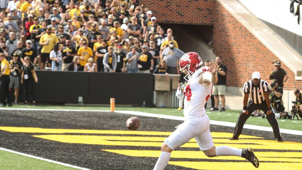 Freshman punter James Evans kicks the ball during the game against the University of Iowa Sept. 4, 2021, in Kinnick Stadium in Iowa City, Iowa.