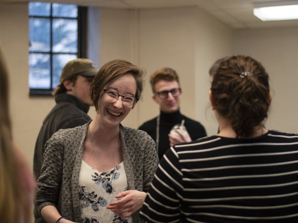 Freshman Missy Hamilton laughs during an exercise Feb. 21 in her P155: Public Oral Communications discussion section. Public Oral Communications is a required class for students in the College of Arts and Sciences.