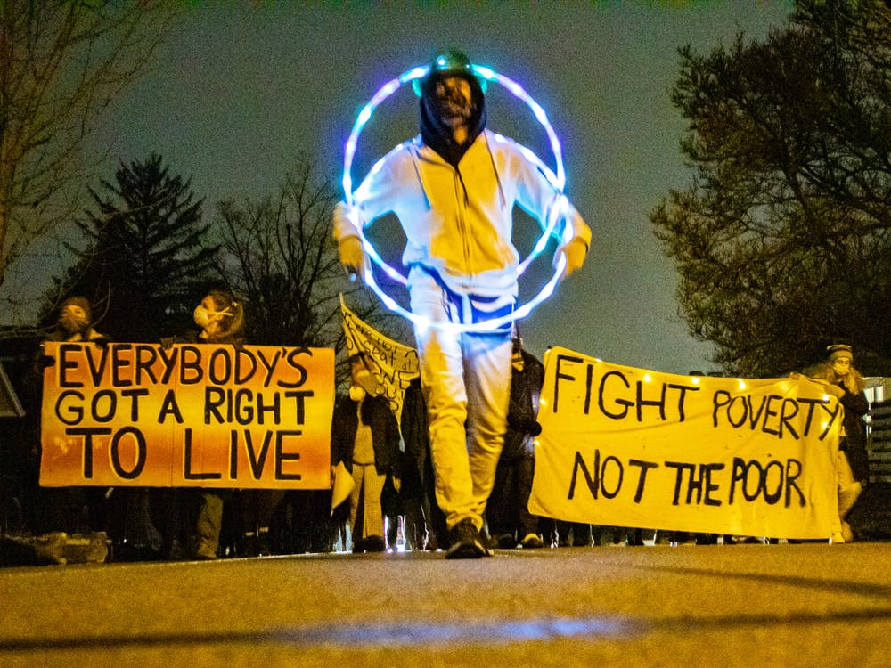 Protestors make their way down 1st St. towards Mayor John Hamilton's house Jan. 18. The protest came after people experiencing homelessness were evicted from Seminary Park by Bloomington Police Department personnel and other city employees on Jan. 14.