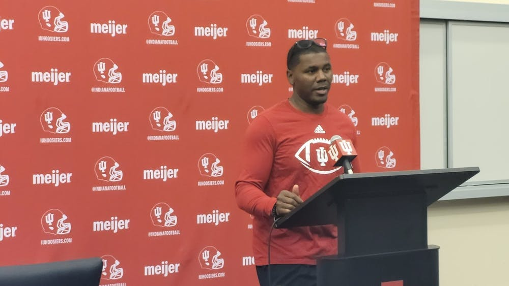 IU football associate head coach and running backs coach Deland McCullough speaks to the media Friday. McCullough said he is encouraged by the team's walk-on running backs at the press conference.