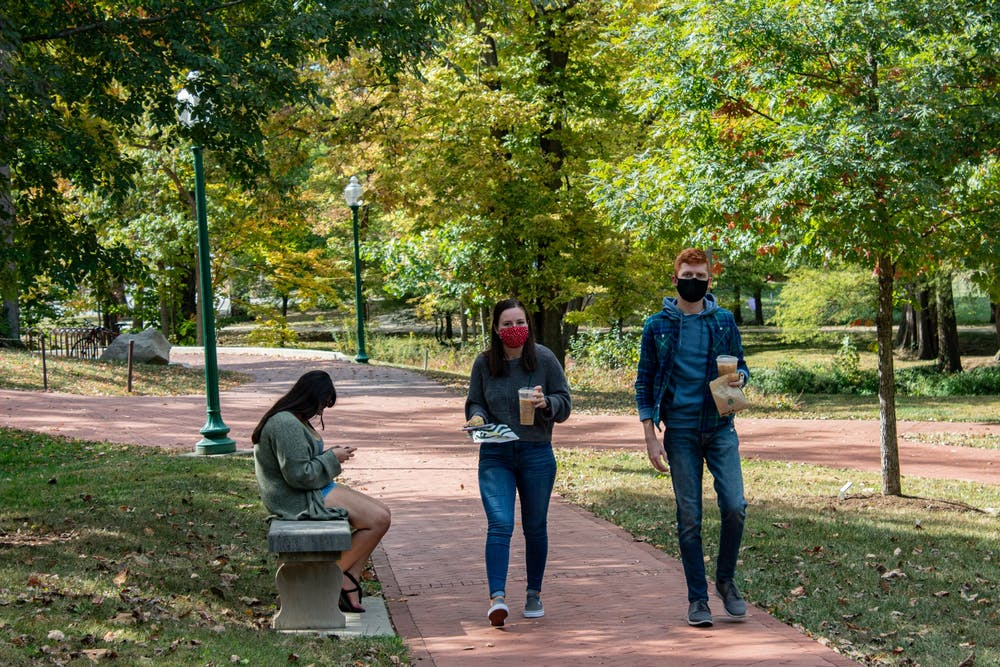 <p>Students walk along a trail Oct. 15, 2020, by the Campus River near Dunn Meadow. IU health expert Jacek Kolacz suggests that taking breaks from looking at screens can be helpful for students&#x27; mental health during the spring semester. </p>