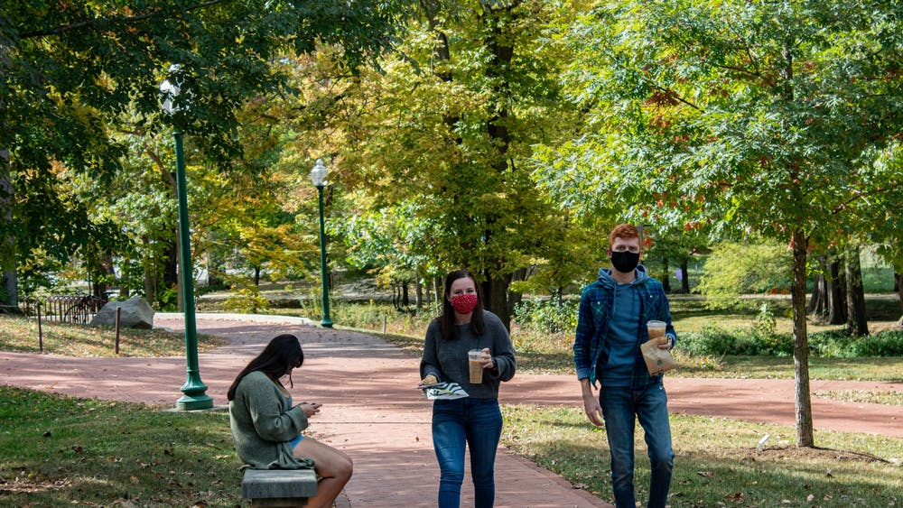 Students walk along a trail Oct. 15, 2020, by the Campus River near Dunn Meadow. IU health expert Jacek Kolacz suggests that taking breaks from looking at screens can be helpful for students' mental health during the spring semester.