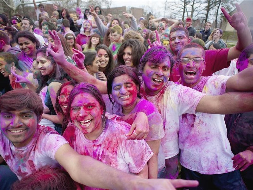 Students and community members celebrated Holi, a Hindu festival welcoming the beginning of Spring, on Friday, March 25, 2011 in Dunn Meadow. Known as the Hindu 'Festival of Colors,' devotees traditionally cover eachother with crushed and dyed rose petals which are meant to equalize all people despite their social status or gender.