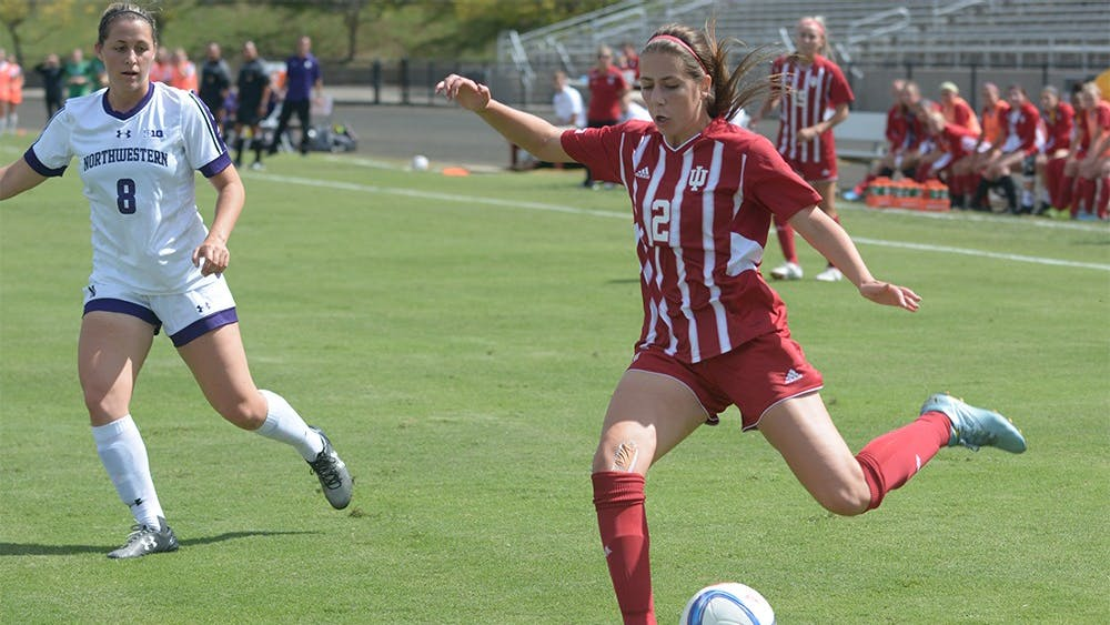 Senior midfielder Jessie Bujouves strikes the ball during the game against Northwestern University on Sunday afternoon at Bill Armstrong Stadium. IU tied the game 1-1.