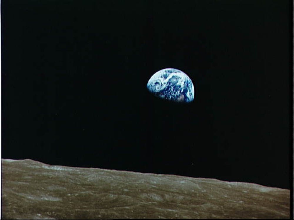 View of rising Earth about five degrees above the Lunar horizon from the Apollo 8 spacecraft December 22, 1968.