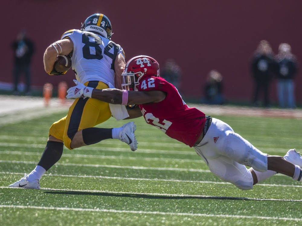 Then-sophomore defensive back Marcelino Ball attempts to tackle Iowa then-senior wide receiver Nick Easley during the homecoming game Oct. 13, 2018, at Memorial Stadium. No. 17 IU opens its season against No. 18 Iowa on Saturday in Iowa City, Iowa.
