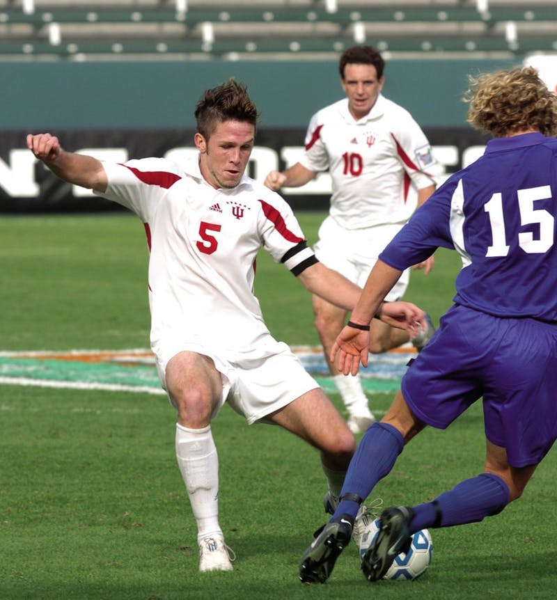 b58537cf5aa ... past a Maryland player during a 2004 NCAA College Cup semifinal match  at the StubHub Center