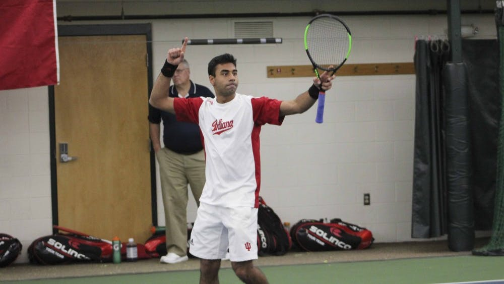 Then-junior Raheel Manji celebrates his doubles win against Princeton on Saturday, Feb. 4, 2017, in Bloomington. IU lost to Vanderbilt and defeated Saint Louis this weekend.