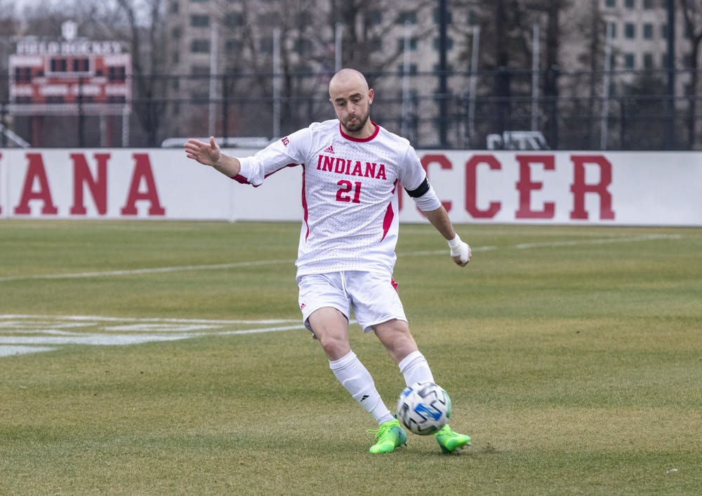 <p>Redshirt senior defender Spencer Glass passes the ball Monday in Bill Armstrong Stadium. IU won against Michigan State 2-1. </p>