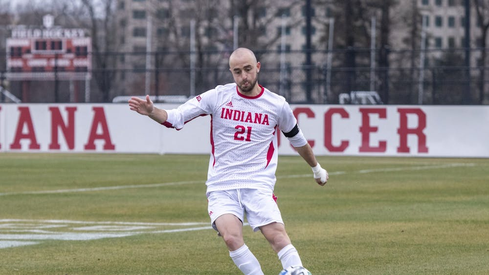 Redshirt senior defender Spencer Glass passes the ball Monday in Bill Armstrong Stadium. IU won against Michigan State 2-1.