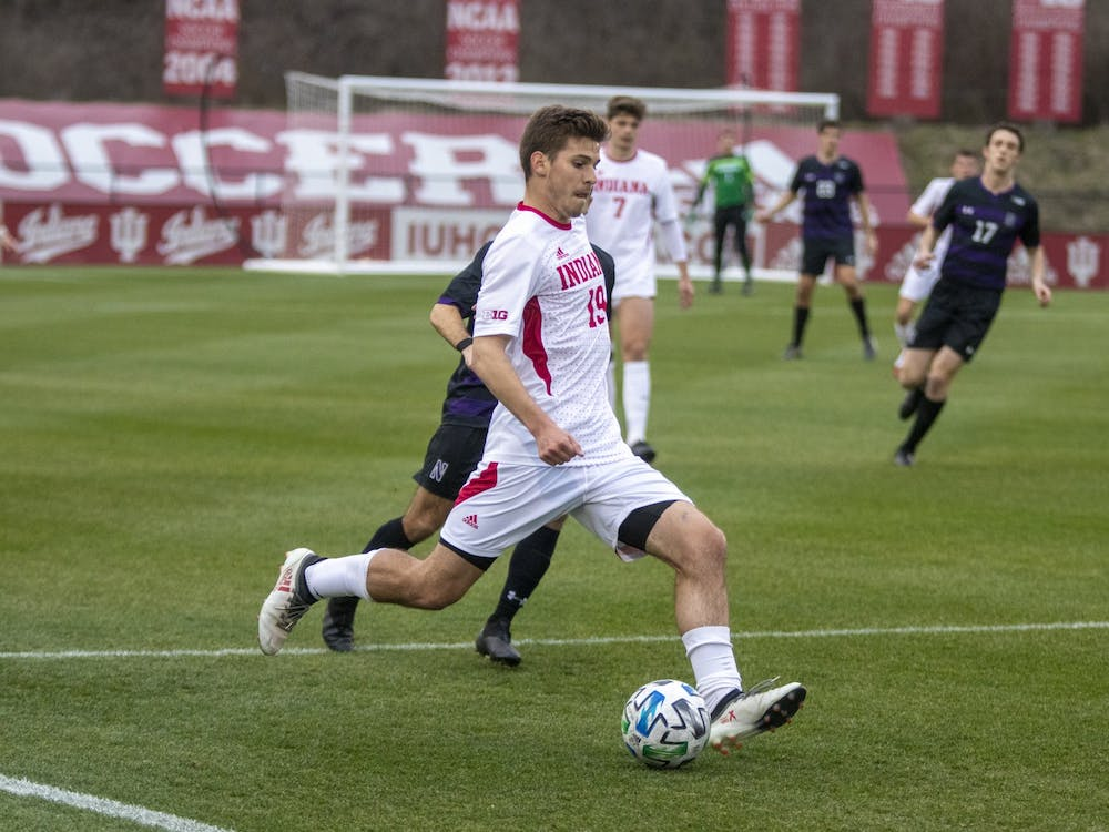 Sophomore Brett Bebej passes the ball March 23 in Bill Armstrong Stadium. IU fell 1-0 to Marshall University in overtime of the NCAA Championship on Monday in Cary, North Carolina.
