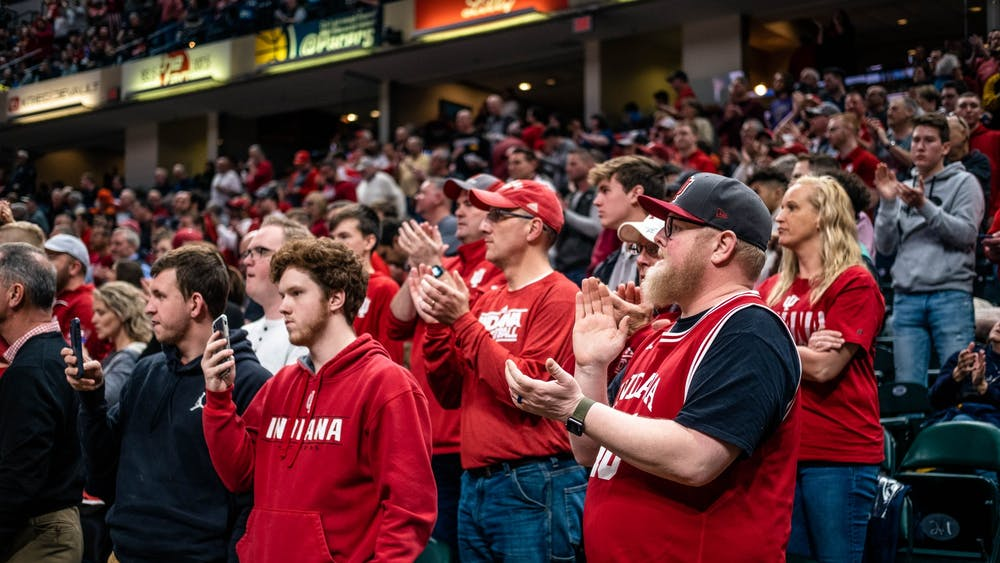 IU fans cheer as the men's basketball team takes the court March 11 at Bankers Life Fieldhouse. IU played Nebraska in the first round of the Big Ten Tournament.