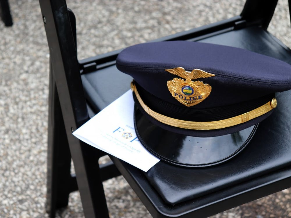 A police officer's hat sits on top of a program for the Peace Officers Memorial.